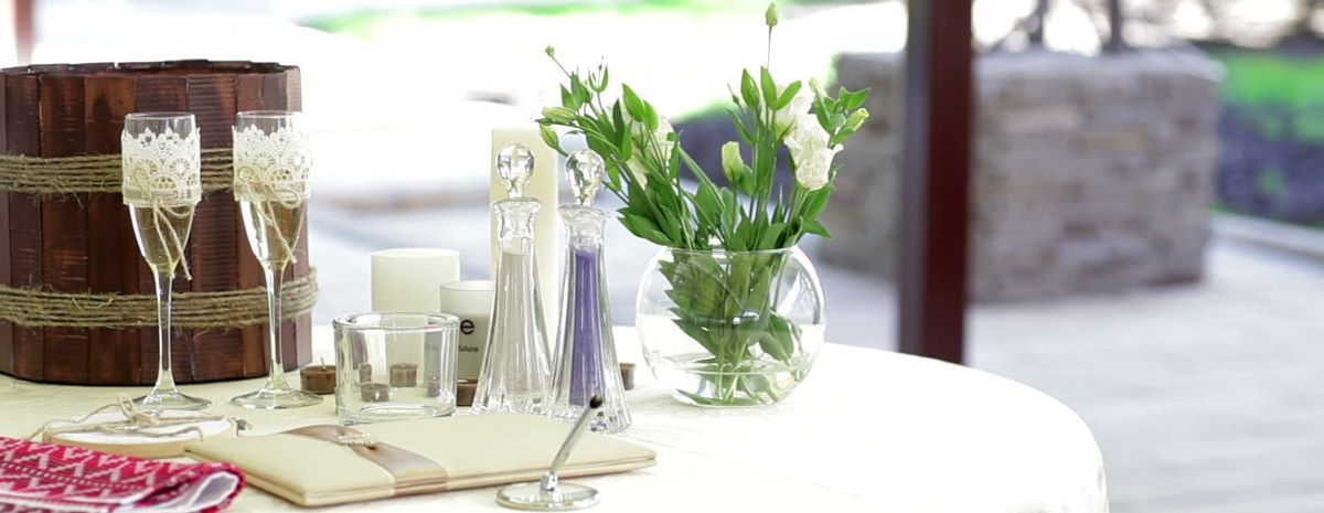 stock-footage-table-with-wedding-accessories-and-two-glasses